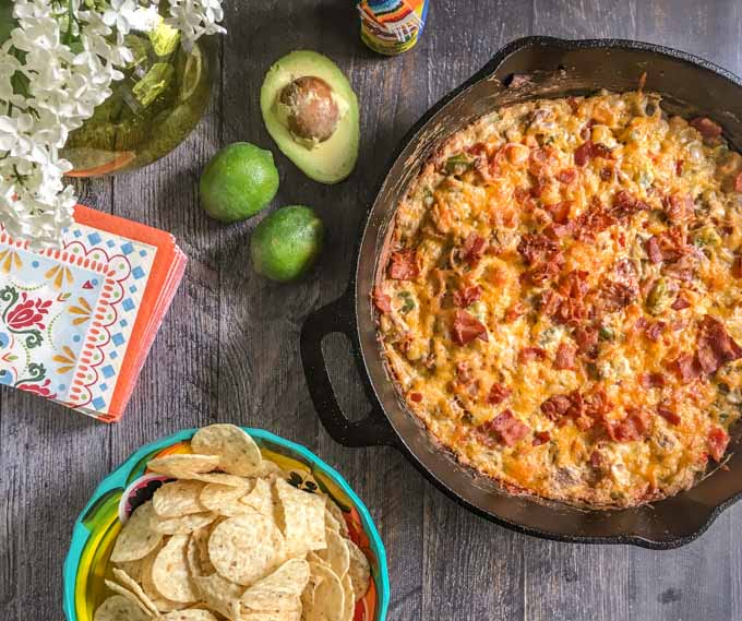 This alambre skillet cheese dip is has got it all: steak, peppers, onions, cheese and yes even bacon! A fun appetizer to celebrate Cinco de Mayo.