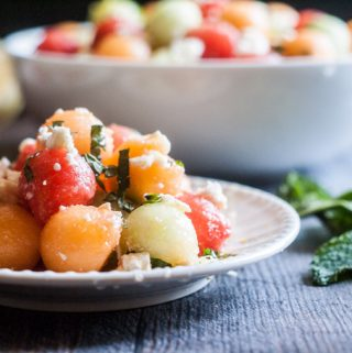 This feta melon salad with lemon & mint is perfect for spring and summer. It's sweet and savory and a delicious salad or side dish for your next party.