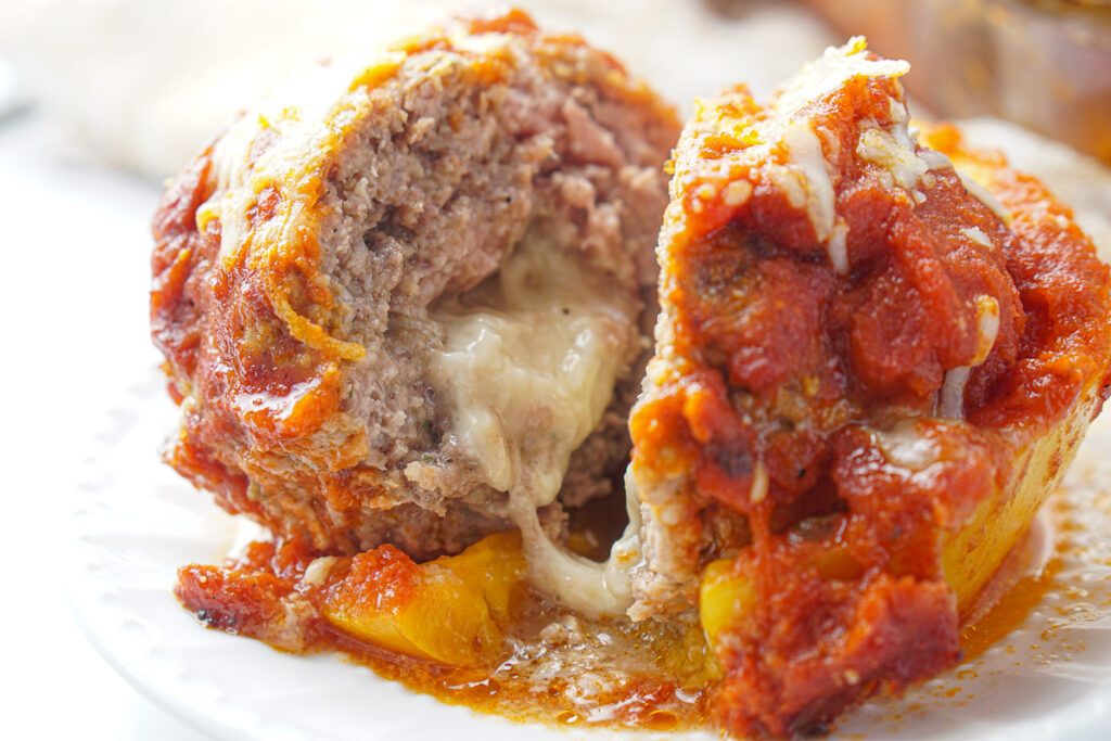 cut meatball pepper with cheese oozing out