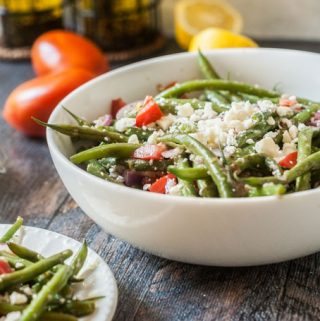 This Greek green bean salad is the perfect summer salad. Using vegetables from your garden or farmer's market, you can make this delicious vegetarian salad in minutes.