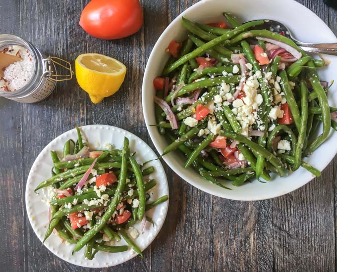 This Greek green bean salad is the perfect summer salad. Using vegetables from your garden or farmer's market, you can make this delicious vegetarian salad in 15 minutes.