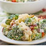 white bowls of keto broccoli cauliflower salad with bacon and text
