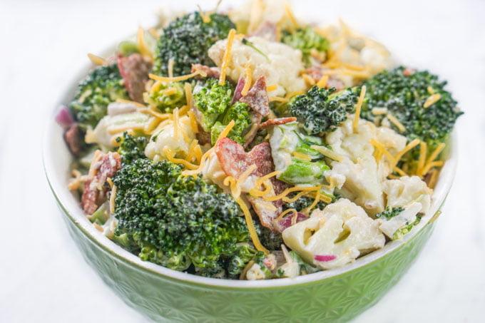 green bowl with keto broccoli cauliflower salad