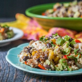 This Caribbean chicken quinoa salad is perfect for a summer dinner or picnic. Full of colorful fruit and vegetables and topped with spicy jerk chicken and chewy quinoa.
