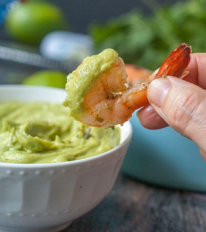 This cilantro lime shrimp cocktail is a delicious low carb snack or lunch. The creamy avocado dipping sauce goes perfectly with the garlicky, herbal marinated shrimp. Can eat hot or cold.