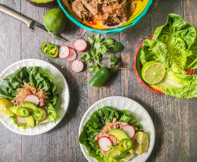 These slow cooker pork carnitas lettuce wraps are a great low carb dinner that take minutes to make. Get the slow cooker ready the night before and have diner on the table in 5 minutes!