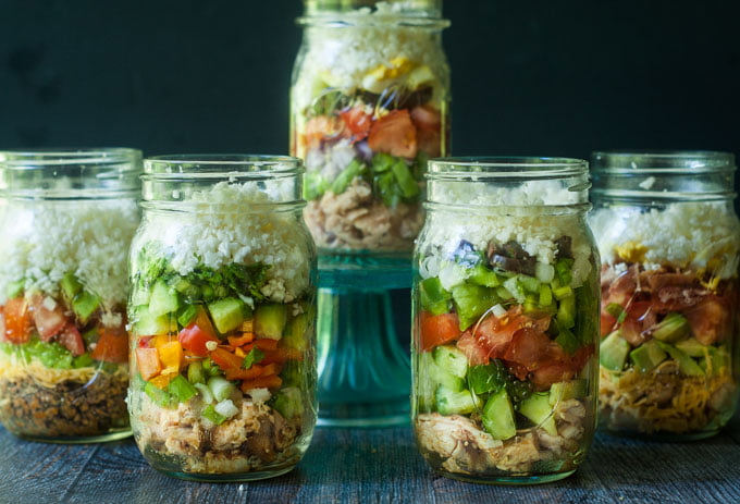 Here are 5 low carb cauliflower salad jars you can take or eat for lunch this week. All full of healthy, satisfying ingredients and come in the following flavors: Mexican, Cobb, Asian, Nicoise and Greek.
