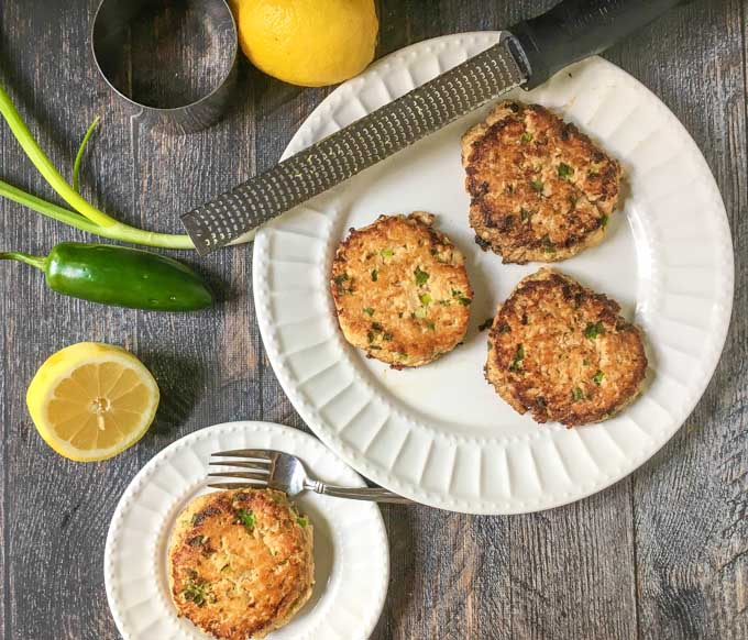 These lemon jalapeño salmon cakes are a quick and easy, low carb dinner that you can make in minutes. The fresh lemon and jalapeño add bright flavor to canned salmon. Only 1.4g net carbs per cake.