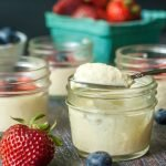 This patriotic low carb vanilla mousse is a breeze in the Instant Pot. Decorated with strawberries and blueberries, these cute little jars only have 2.5g net carbs!
