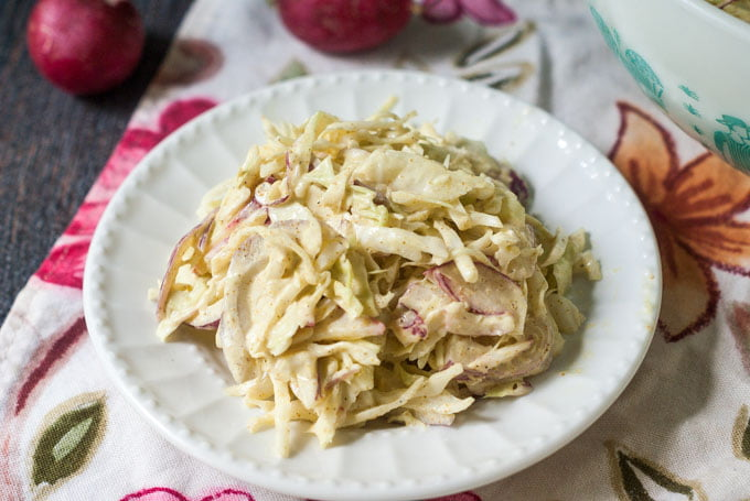 This radish & cabbage curried coleslaw is a tasty change of pace from your usual coleslaw. It's also low carb at only 3.2g net carbs per serving.