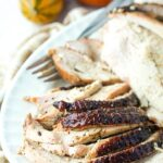 white platter with sliced smoked turkey breast with text overlay
