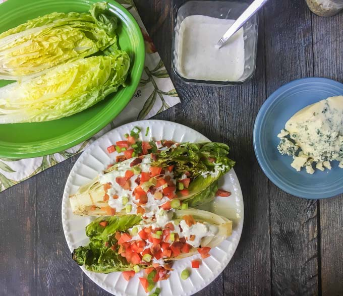 This grilled Romaine wedge salad is a fun light summer dinner and tastes great with a the low carb blue cheese dressing! Only 1.2g net carbs for 2 tablespoons of this yummy blue cheese dressing.