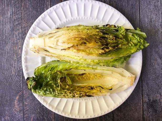 This grilled Romaine wedge salad is a fun and light summer dinner and tastes great with the low carb blue cheese dressing! Only 1.2g net carbs for 2 tablespoons of this yummy dressing.
