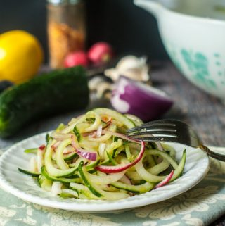 These lemon ginger Asian cucumber noodles make a refreshing salad that you can make in minutes. These cucumber noodles are perfect for picnics or even a light dinner. Best of all those huge cucumbers from the garden work great in this dish!