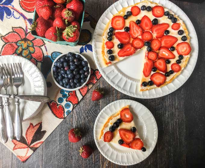This fathead fruit pizza is a delicious low carb dessert that is perfect for a summer party. It's also gluten free and only has 4.2g net carbs per piece!