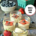 glass jars with keto vanilla mouse decorated with berries and text