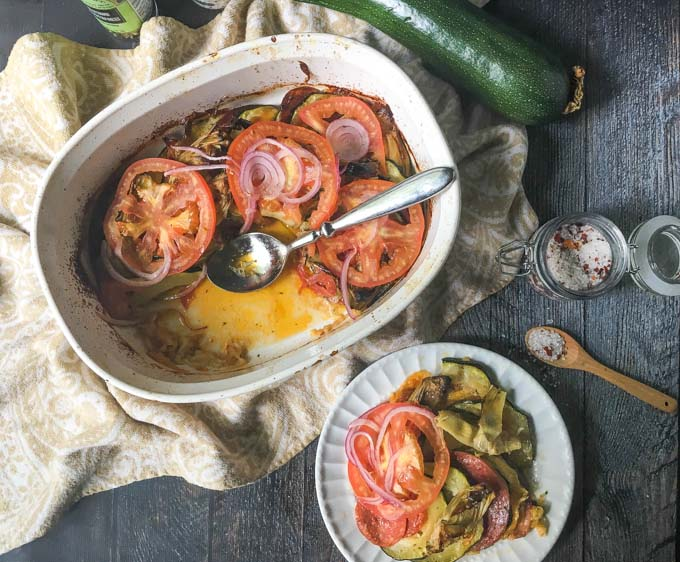 This garden zucchini antipasto casserole is the perfect dish to make with all of those huge zucchini you get from your garden this summer. Layers of zucchini, meats and cheeses are topped with artichokes, tomatoes and onions.