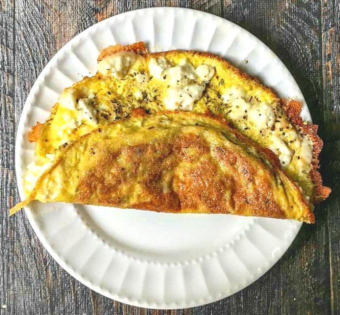 Greek feta keto omelet on white plate