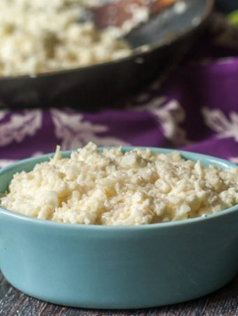 This easy Asiago cauliflower rice is a delicious low carb dish you can make in 15 minutes with only 3 ingredients. Only 3.4g net carbs per serving!