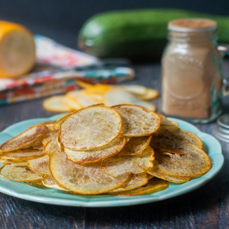 These low carb cinnamon zucchini chips are easy to make and a great way to use zucchini from the garden. Plus 25 of these chips have only 15 calories and 1.8g net carbs!