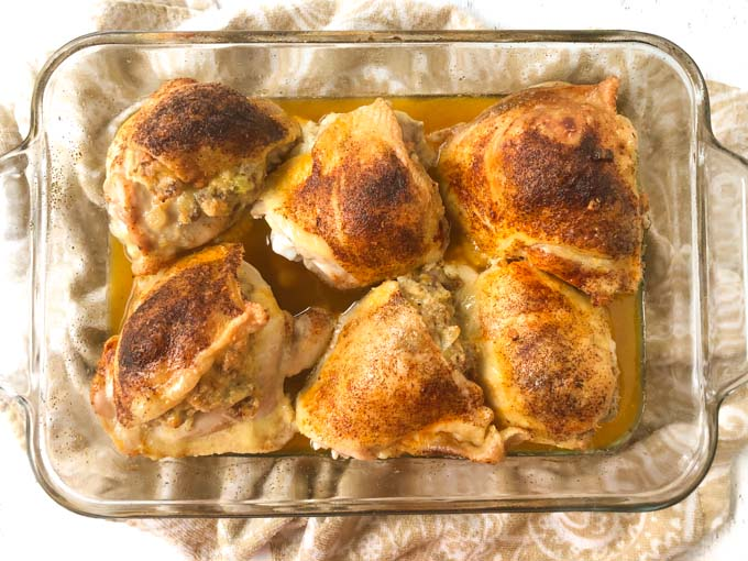 baking dish with cooked stuffed chicken thighs with low carb sausage stuffing