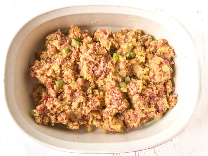 uncooked low carb stuffing in a white baking dish