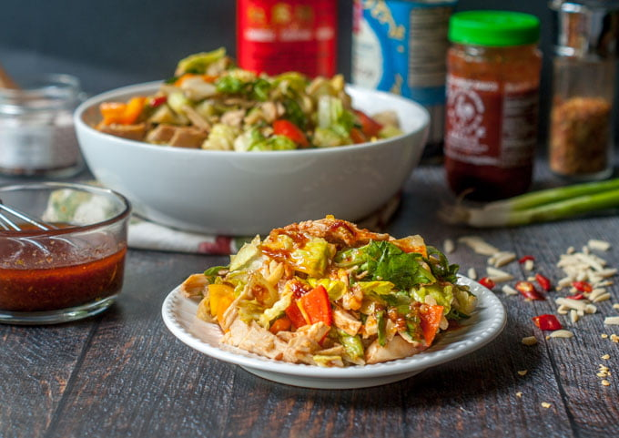 This Kung Pao chicken salad is a delicious and healthy dish to satisfy that take out craving. This low carb recipe has a  Kung Pao dressing that is full of flavor and easy to whip up.