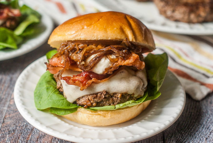 This decadent bacon cheeseburger with balsamic onions & garlic aioli is the perfect combination. Sweet onions, salty bacon, creamy Swiss and garlicky aioli make the perfect combination. Skip the bun to make it low carb!