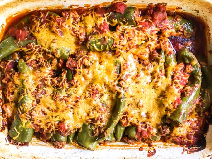 These cheesy chorizo stuffed chiles are an easy and tasty appetizer that's low carb too. The spicy chorizo and the melty cheese make these peppers a winner!