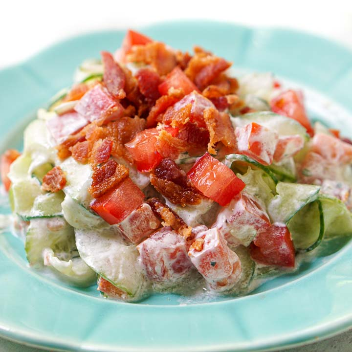 blue plate with creamy cucumber ranch and bacon salad
