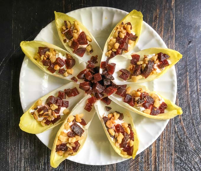 If you are in need of a quick and easy appetizer, this beet & goat cheese stuffed endive is the way to go. Only a few minutes a couple ingredients to make this beautiful and tasty dish.