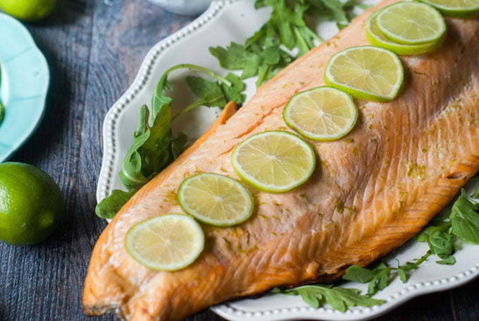This lime margarita grilled salmon is a delicious and simple low carb dinner. The garlicky avocado mayo goes perfectly with the tangy lime infused salmon and has only 1.5g net carbs per serving.