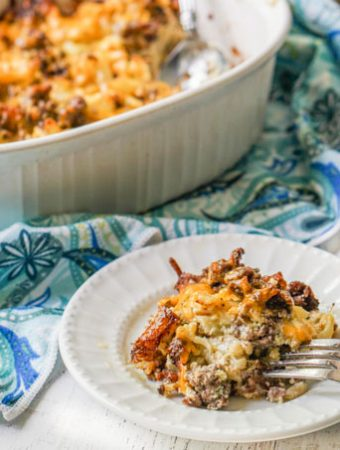 plate of keto casserole with baking dish and blue dish towel