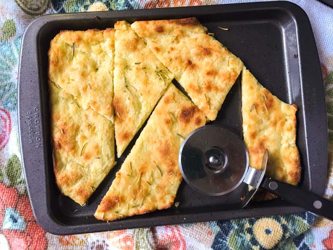 small cookie sheet with cooked keto garlic flatbread