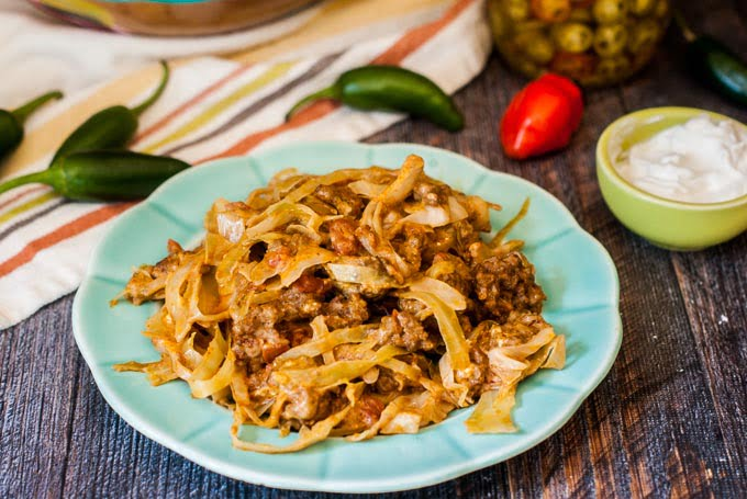 This slow cooker low carb Mexican casserole needs only 6 ingredients. It's cheesy, creamy and full of those spicy Mexican flavors. Each serving is only 6.2g net carbs.