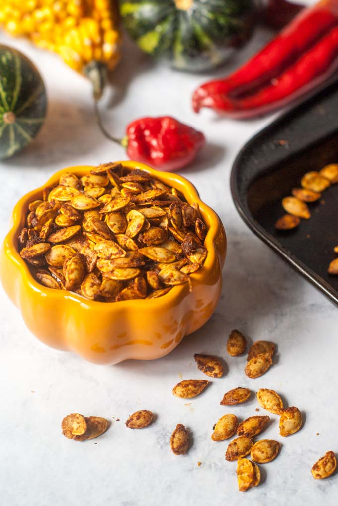 These roasted Thai curry pumpkin seeds are addicting! You've got to try this nice little twist when you make your roasted pumpkin seeds this fall.