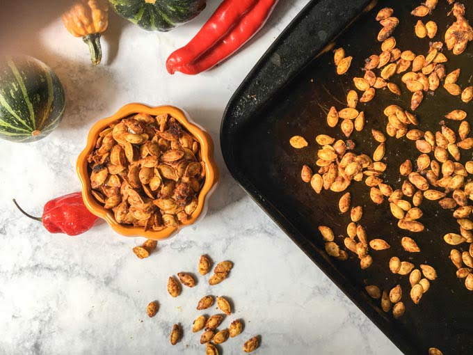 These roasted Thai curry pumpkin seeds are addicting! You've got to try this nice little twist when you make your roasted pumpkin seeds this fall. Only 2.1g net carbs per serving.