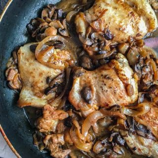This skillet chicken with balsamic onions & mushrooms is a flavorful dish with creamy sweet onions and earthy mushrooms sauteed with chicken thighs. This is a low carb meal that everyone will love with only 6.0g net carbs!