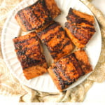 large and small white plates with Asian glazed salmon with text