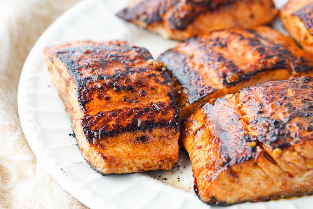 closeup of a plate of Asian glazed keto salmon filets