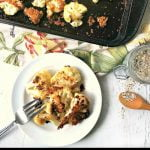 cookie sheet and white plate with rosemary parmesan cauliflower bites and text overlay