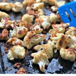 cookie sheet with rosemary parmesan cauliflower bites and text overlay