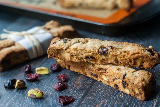 cranberry & pistachio biscotti  with scatter cranberries and pistachios
