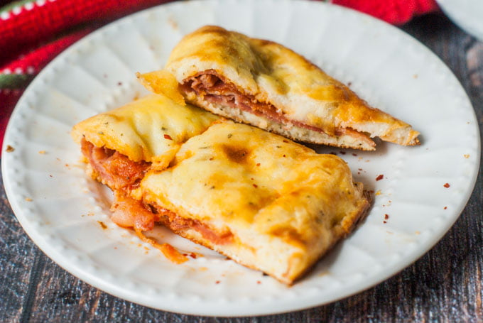 This low carb meat calzone is the perfect handheld pizza. Using fathead dough and tasty Italian meats you can make these calzones, quickly and easily. Only 5.7g net carbs per serving.
