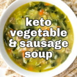 white bowl keto sausage & vegetable soup on beige tea towel with text