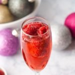 This low carb holiday raspberry mimosa is the perfect drink to sip on Christmas morning or New Year's eve. Lightly sweet and easy to make you will want to drink them all year round.