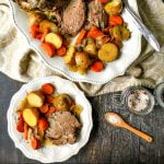 platter with slow cooker lamb roast and vegetables with text