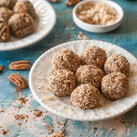 These low carb chocolate cheesecake bites are the perfect dessert or snack to have on hand when your sweet tooth comes a calling. Creamy chocolate cheesecake rolled in crunchy toasted coconut or toasted pecans for only 0.6g net carbs per bite.