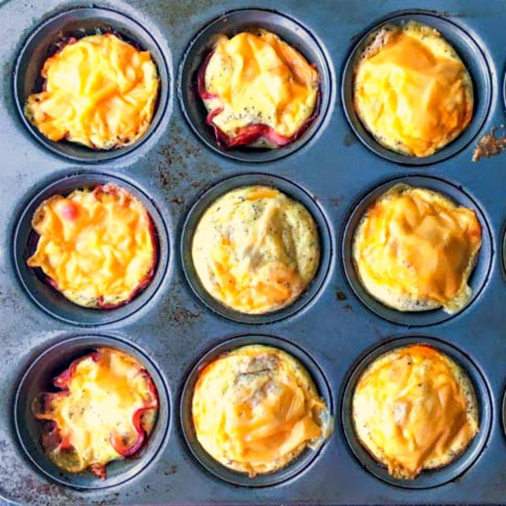 muffin tin with baked sausage egg cups and ham and egg cups