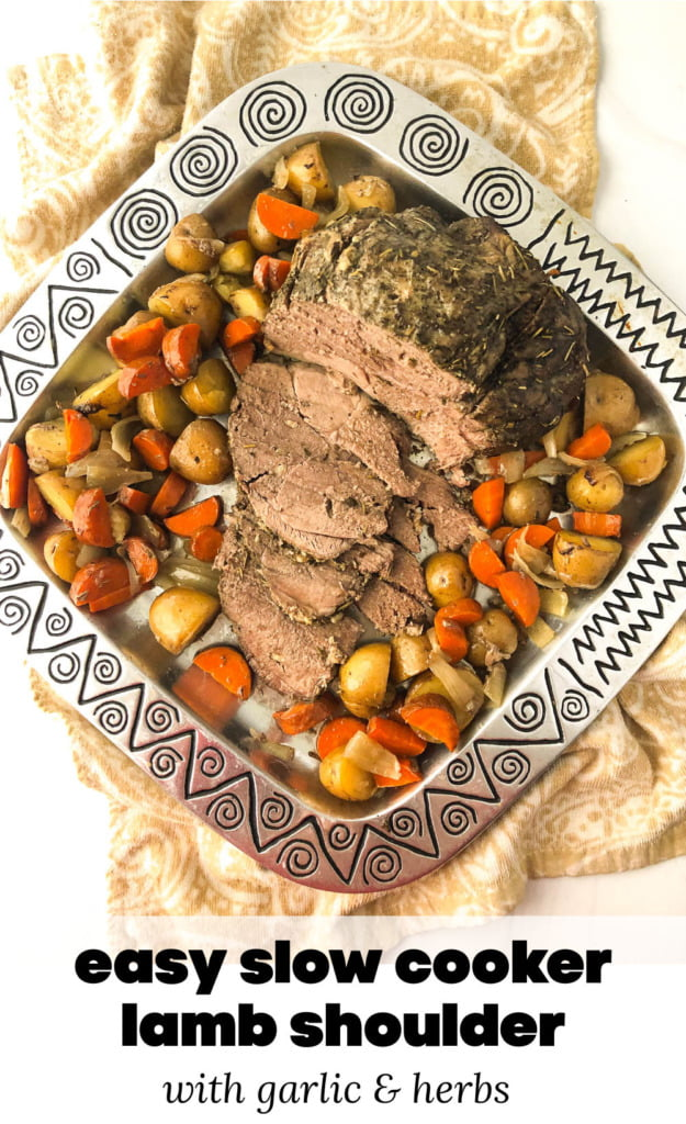 metal platter with slow cooker lamb should and scatter roasted potatoes and carrots with text overlay